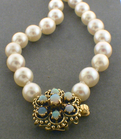 16 inch 6.3-7.0mm pearl necklace with opal 14 karat clasp.