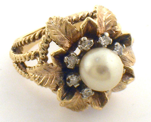 14 karat yellow gold pearl and diamond ring weighing 13.4grams. Pearl is 8mm and diamond weigh is approx .16ct tw, Finger size 7.75