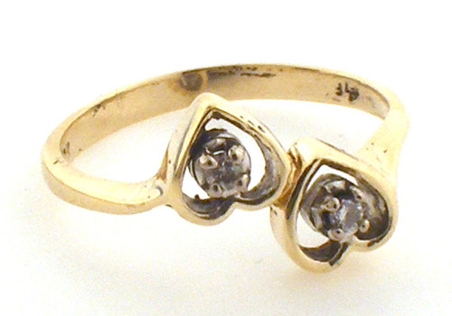 10 karat yellow gold double heart ring weighing 2.3 grams, Diamonds weigh approx .03 ct tw. Finger size 7.5
