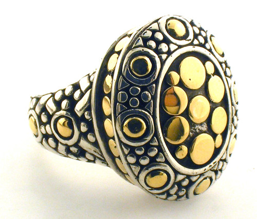 18 karat yellow gold and sterling John Hardy ring. Finger size 6.25