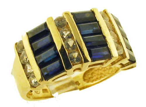 This is a 14 Karat yellow gold ring CZ and sim blue sapphires. The ring weighs 4.4 grams and is for a finger size of 5.5