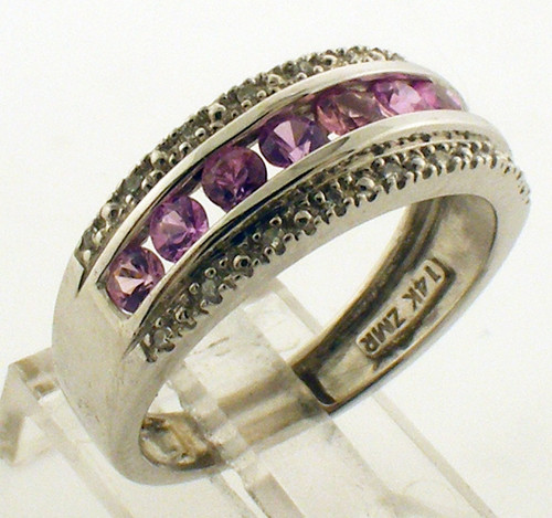 This is a 14 karat white gold ring with Pink sapphire and Diamonds. The total weight of the ring is 2.9 grams and is for a finger size 6.