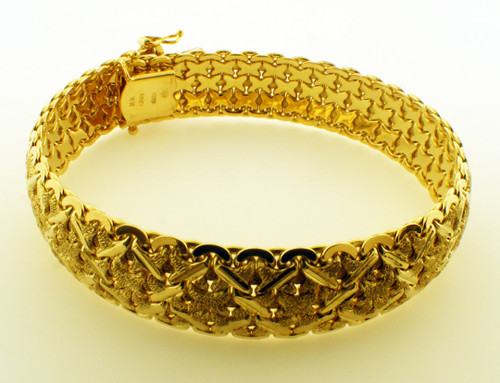 This is a 14 Karat yellow gold bracelet. The TW of the bracelet is 35.2 grams and the total length is 7 inches.