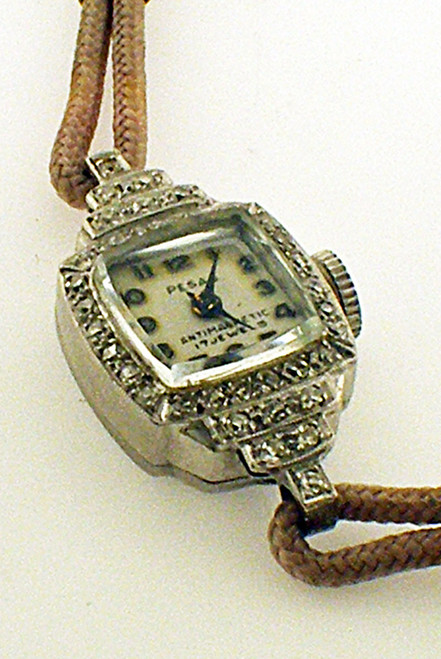 Pesag platinum watch with 17 diamonds. The TW of the Dia is .35ct and the TW of the watch is 10.8 grams.