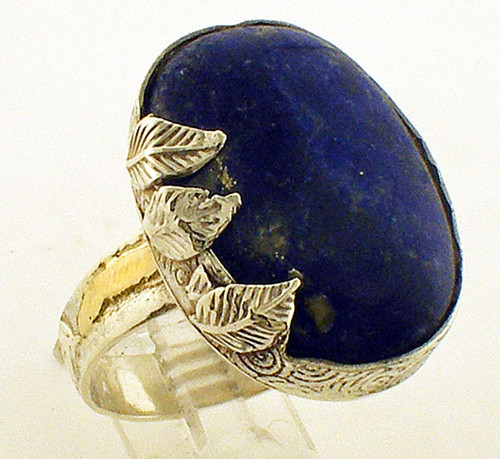 This is a sterling silver ring with a Lapis center stone. The total weight of the ring is 16.4 grams and for a finger size of 15.