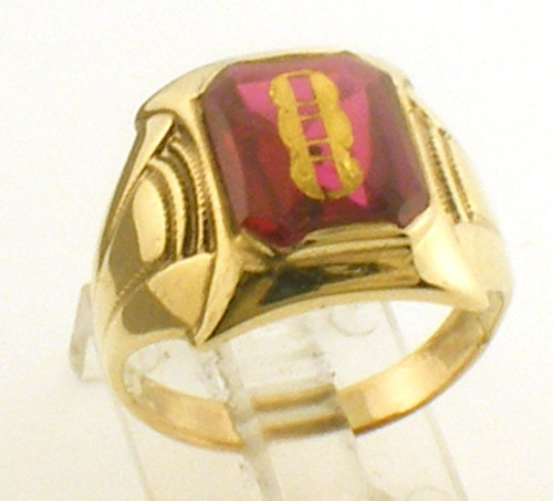 This is a 10 karat yellow gold ring with a simulated ruby for the center stone. The total weight for the ring is 3.2 grams and is for a finger size of 5.75