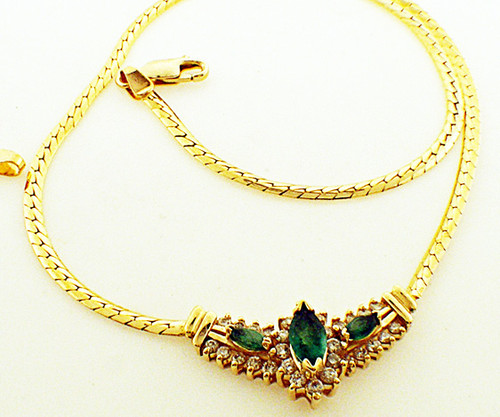 14 karat yellow gold 17 inch emerald and diamond necklace weighing 9.2 grams. Diamonds weigh a total of approx .50ct tw