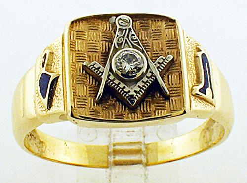 10 karat yellow gold masonic ring weighing 9.5 grams. Finger size 15. Diamond weigh approx .10ct.