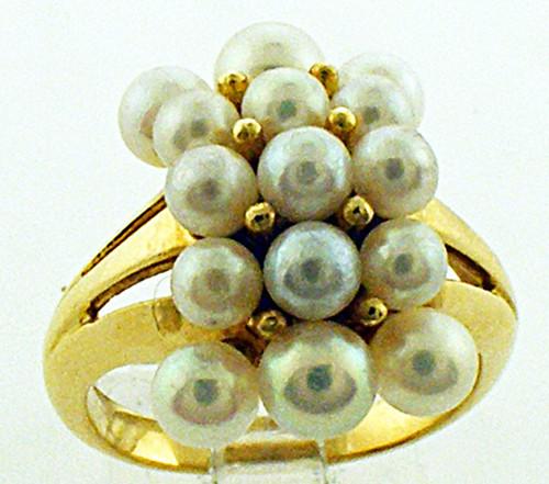 18 karat yellow gold pearl cluster ring weighing 6.3 grams. Finger size 4.75