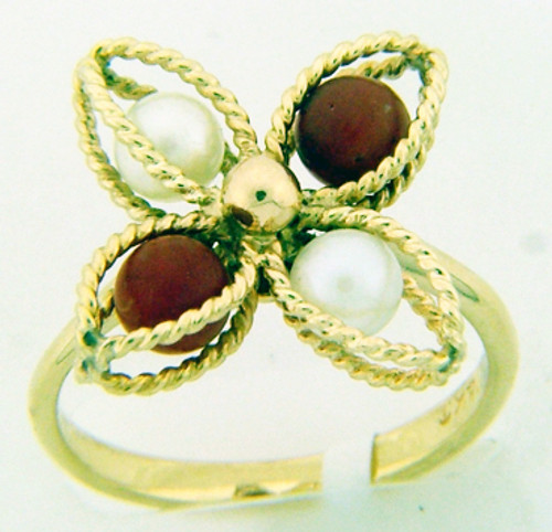 14 karat yellow gold pearl and coral ring weighing 3.3 grams. Finger Size 6.5