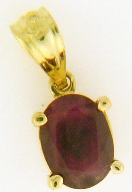 14 karat ruby pendant weighing .8 grams Ruby is 6.8 x 5mm