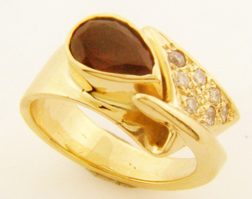 14 karat yellow gold synthetic ruby and diamond ring weighing 9.0 grams. Finger Size 5.5