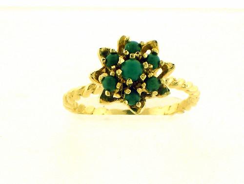 14 karat yellow gold turquiose cluster ring weighing 3.4 grams. Finger size 7.25
