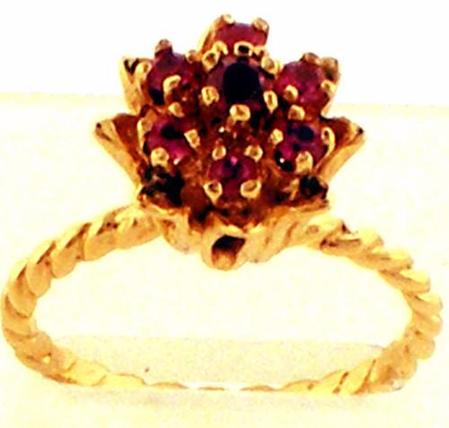14 karat yellow gold ruby flower cluster ring weighing 3.5 grams. Finger Size 7.25