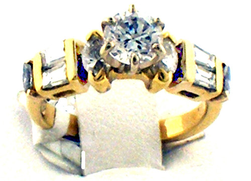 18 karat yellow gold diamond semi mount ring weighing 4.1 grams. Center stone is a cubic zirconia . Diamonds weigh approx .60ct TW. G-H, VS