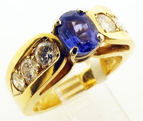 14 karat yellow gold tanzanite and diamond ring weighing 7.3 grams. Finger size 6.25. Tanzanite = .91 carat. Diamonds weigh approx .70 carat total weight