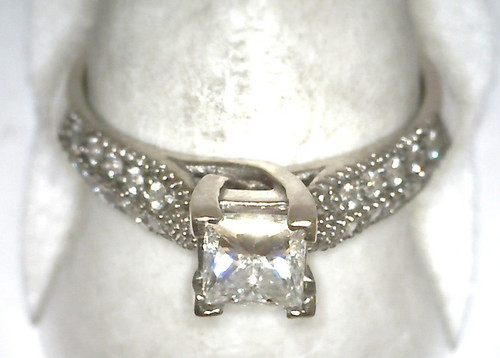 14 karat white gold diamond engagement ring weighing 3.4 grams. Center diamond is a .57ct princess cut G, VS, Finger size 5