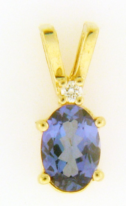 14 karat yellow gold tanzanite and diamond pendant weighing .6 grams. Tanzanite is 6 x 4 mm and diamond approx .02ct