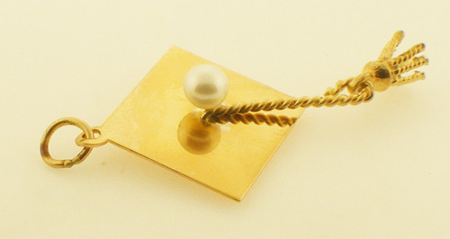 14 karat yellow gold graduation charm with pearl weighing 2.7 grams