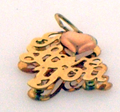 """This is a 14 karat yellow gold """"i love you"""" charm with a little heart on top. The total weight of the charm is 0.7 grams."""