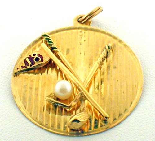 This is a 14 karat yellow gold charm that can double as a pendant. This item is two golf clubs with am hole 18 flag with a pearl as a golf ball. The total weight of the piece is 3.6 grams.