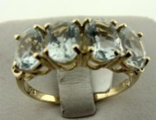 This is a 10 karat yellow gold ring with four aquamarine stones. The TW of the gems are 3ct and the total weight of the ring is 3.0 grams. The ring was made for a finger size of 10