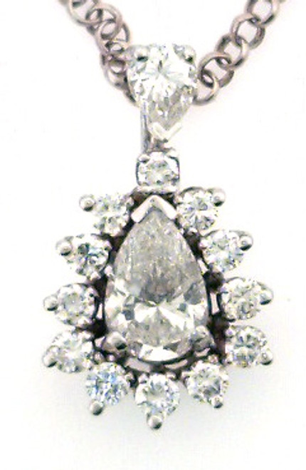 14 karat white gold diamond pendant weighing 2.0 grams.  Center diamond is approx .91ct  H-I, SI2.  Total diamond weight is approx 1.45ct tw