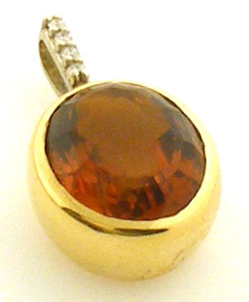 14/18kt 2 tone citrine and diamond pendant. Bale is 14 karat white gold with diamonds. Citrine is set in an 18kt yellow gold bezel. Citrine measures 10 x 8 mm.