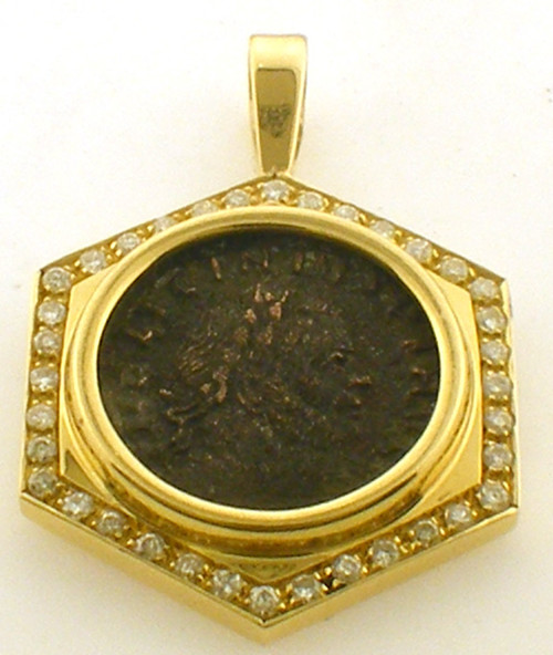 This is an 18 karat yellow gold pendant with Diamonds surrounding an antique coin. This piece is a LICINIO and is numbered 308/324.The total weight of the diamonds is .40ct and the total weight of the pendant is 12.6 grams.