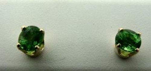 These are 14 karat yellow gold earrings with tsavorite stones. The total weight of the earrings is 1.2 grams.