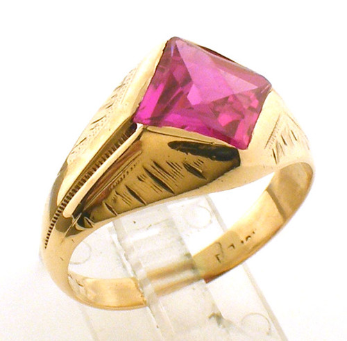 This is a 10 karat yellow gold ring with a simulated ruby center stone. The total weight of the ring is 4.2 grams and is made for a finger size of 8.5