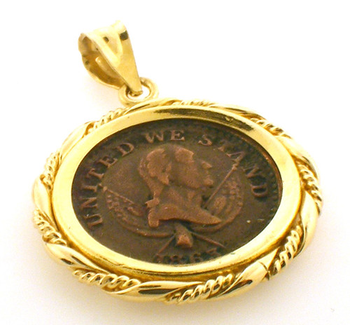 14 karat yellow gold pendant with a civil war penny weighing 6.4 grams