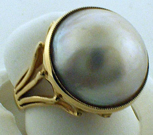 14 karat yellow gold 16mm mabe pearl ring weighing 7.3 grams. Finger size 6.25. Orginal sale price $625. Clearance price $375.