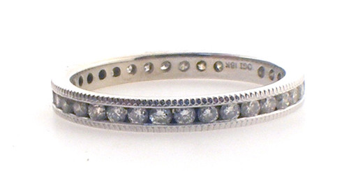 18 karat white gold diamond eternity ring weighing 2.0 grams. Diamond are approx .33ct TW