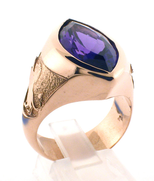This is a smaller marquise shaped ring with a genuine marquise shaped amethyst.    The weight of the ring in 14 karat pink gold is  approx 26 grams.
