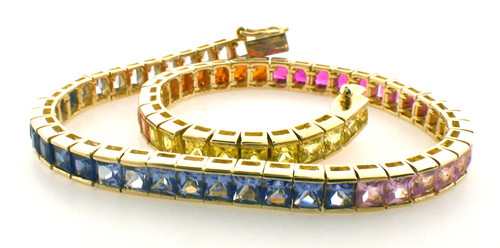 10 karat yellow gold rainbow tennis bracelet 7.5 inches in length.  Weighs 12.3 grams
