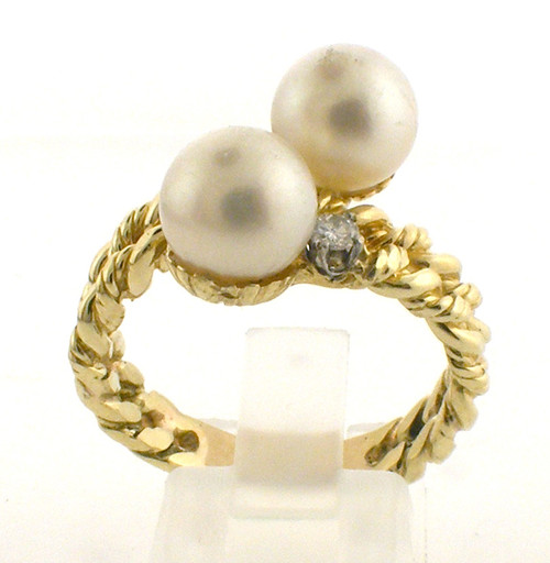 18 karat yellow gold pearl and diamond ring weighing 9.2 grams. Pearls are 8.0 mm Diamond ~.12ct Tw. Size 9.5