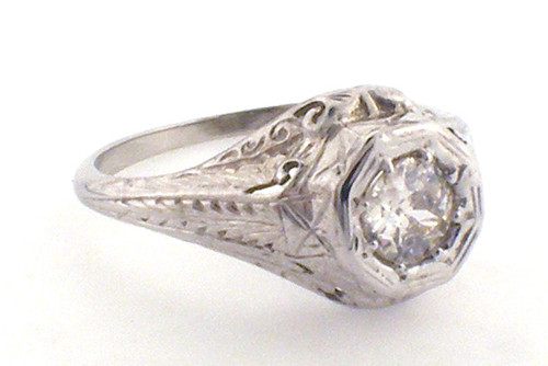 18 karat white gold antique filligree engagement ring weighing 3.2 grams, Finger size 7.75, Diamond is an OEC .47ct K, SI2