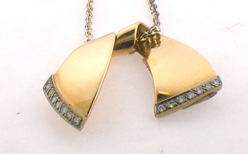 14 karat yellow gold Diamond pendant. An original and handmade piece from Henry Rosenfeld. Weight is 8.9 grams Original sale price $850 - 40% = $510
