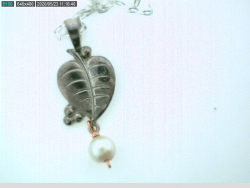 Leaf pendant with a hanging pearl. Original sale price $35 - 40% = $21
