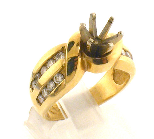 14 karat yellow gold Diamond ring with no center stone. The ring size is a 6.5. The diamond total weight is .56ct. Weight is 7.4 grams. Original sale price $1595 - 40% = $957