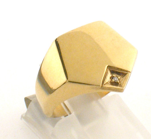 10 karat yellow gold Diamond ring. The ring size is a 5.   weight is 7.9 grams Original sale price $450 - 40% = $270