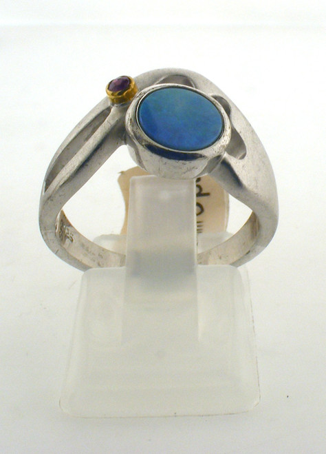 Sterling silver with simulated opal ring. Ring is made for a finger size of 7. The total weight of the ring is 4.8 grams. Original price $90 - 40% = $54