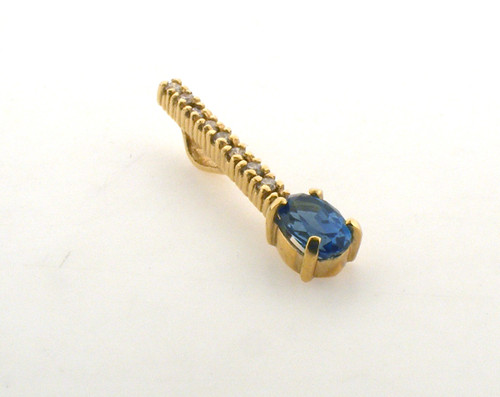14 karat yellow gold blue topaz and diamond pendant. The Diamond total weight is 0.09ct. Original price $285 - 40% = $171