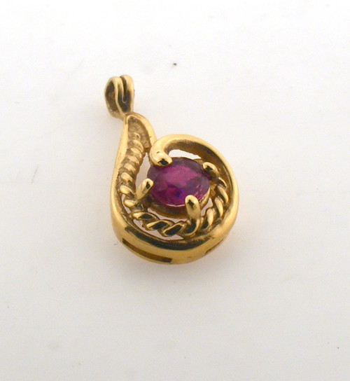 14 karat yellow gold ruby pendant. Original price $140 - 40% = $84