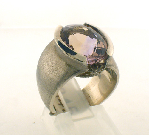 Sterling silver ring with a 8.40ct ametrine center stone. The total weight of the ring is 14.8 grams and the ring is for a finger size of 6.5.