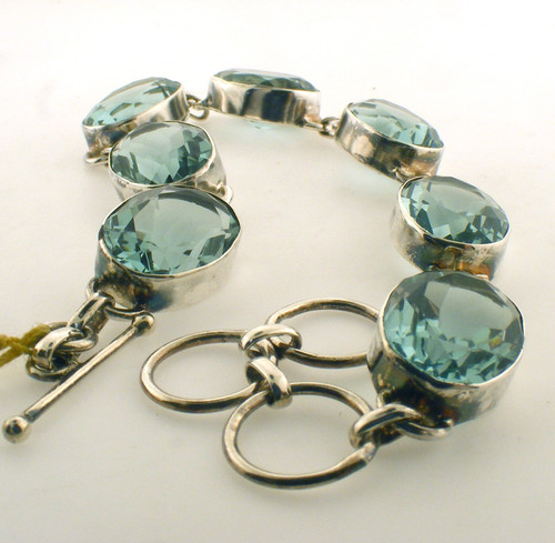 Sterling silver bezel set apatite bracelet. The total adjustable length of the bracelet is 6.5-7.5 inches and the total weight is 16.3 grams.
