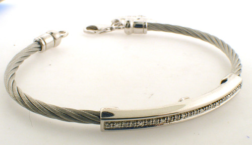 Kable stainless steel bangle bracelet with sterling silver and diamond bar across the top off the bracelet. The total weight of the bracelet is 10.6 grams.