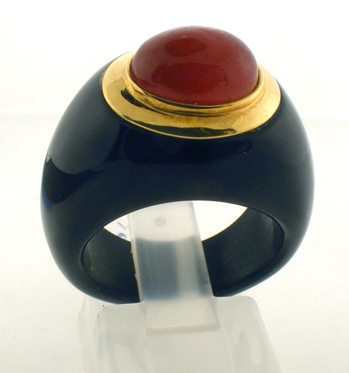 Ceramic and 14 karat yellow gold ring with a carnelian center stone. The total weight of the ring is 7.6 grams and is made for a finger size of 6.