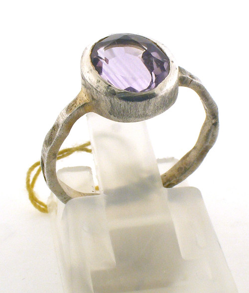 Sterling silver and light purple colored stone ring. The total weight of the ring is 2.1 grams and is made for a finger size of 6.